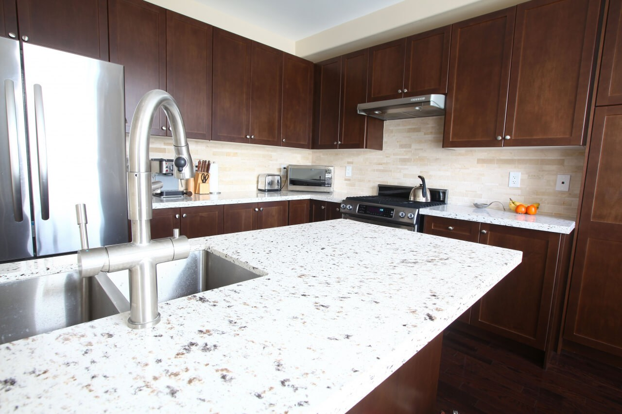 Kitchen countertops and surfaces-Palm Beach Kitchen & Bath Remodeling-We do kitchen & bath remodeling, home renovations, custom lighting, custom cabinet installation, cabinet refacing and refinishing, outdoor kitchens, commercial kitchen, countertops, and more